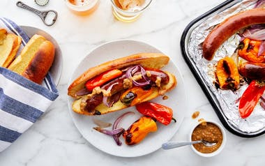 Sheet-Pan Sausages with Sweet Peppers & Onions