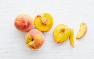 Organic July Flame Yellow Peaches
