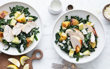Kale Caesar Salad with Roasted Chicken and Crispy Potatoes